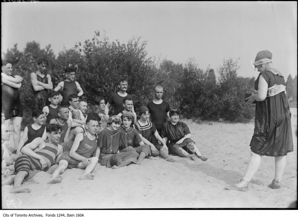 Group of bathers being photographed at Hanlan's Point. - 1913